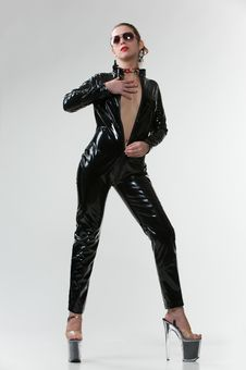 Sexy Wouman In Latex Overalls In Studio Royalty Free Stock Image