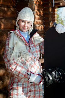 Free Smiling Teenage Girl Holding Snowboard Stock Photography - 18881112