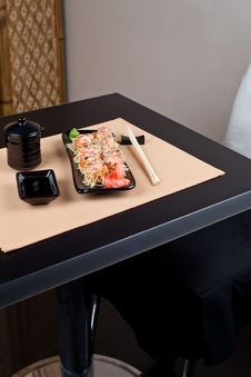 Table Place Setting With Sushi Roll Royalty Free Stock Photos