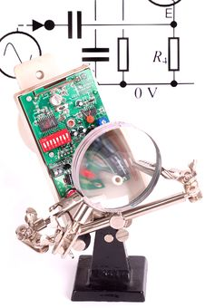 Circuit Board Under A Magnify Glass Stock Photos