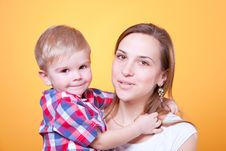 Free Little Boy Embracing His Smiling Mother Stock Photography - 18885682