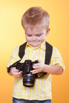 Free Small Smiling Photographer Watch Photo On Camera Stock Images - 18885684