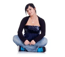 Free Girl In Jeans Sitting In The Lotus Position Royalty Free Stock Photography - 18886217