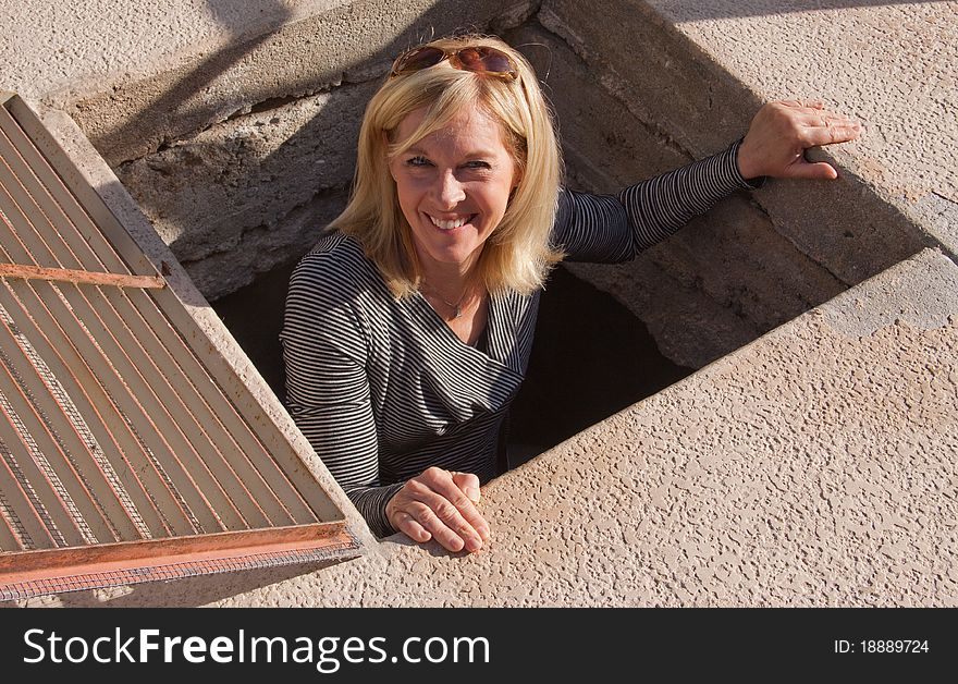 Senior Woman Climbing Out Of A Hole