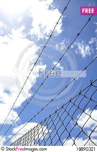Free Fence With Barbed Wire Under Blue Sky Stock Image - 18890321