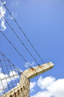 Fence With Barbed Wire Under Blue Sky Stock Images