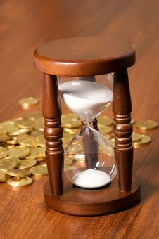 Hourglasses And Coin Royalty Free Stock Image