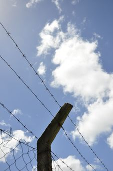 Fence With Barbed Wire Under Blue Sky Royalty Free Stock Images
