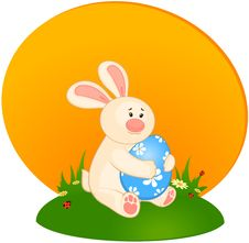 Easter Bunny With Colored Egg. Royalty Free Stock Images