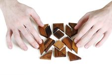 Free Mans Hands Assembling Wooden Square Puzzle Royalty Free Stock Photos - 18895788