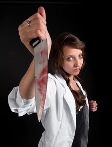 Free Mad Nurse Holds A Bloody Knife Royalty Free Stock Image - 18897186