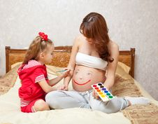Free A Daughter Is Painting On Her Mother`s Belly Stock Photo - 18898270