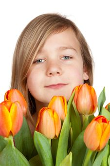 Free Cute Young Girl Is Holding A Bunch Of Tulips Royalty Free Stock Images - 18899979