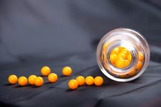 Free Round Yellow Vitamins And Bank Stock Photography - 18900312