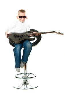 Cute Little Boy Holding A Guitar Stock Photos