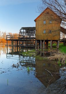 Free Historic Wooden Watermill With Reflection. Stock Photography - 18901112