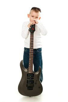 Cute Little Boy Holding A Guitar Royalty Free Stock Photography