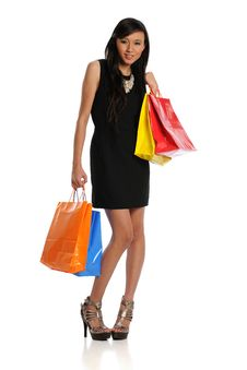 Young Oriental Woman With Shopping Bags Stock Photography