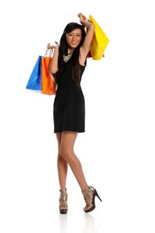 Young Oriental Woman With Shopping Bags Royalty Free Stock Photos
