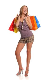 Young Blond Woman Holding Shopping Bags Stock Image