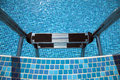 Free Pool Ladder Down, Blue Tiles Royalty Free Stock Photography - 18912887