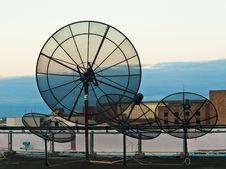Free Black Satellite Dish On High Building Stock Photo - 18910230