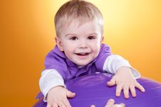 Free Happy Little Boy Laughs Near Violet Ball Royalty Free Stock Image - 18911766