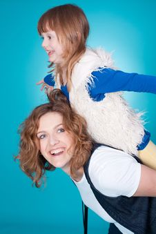 Smiling Mom Play With Daughter On Her Shoulders Stock Image