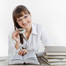 Smiling Girl Reading A Books And Drinking Coffee Stock Photography
