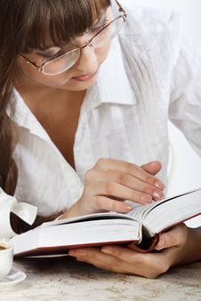 Beautiful Girl Thoughtfully Reading A Book Stock Photo