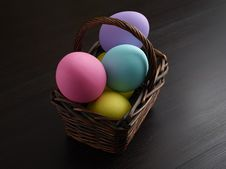 Easter Eggs In Brown Basket Royalty Free Stock Photography
