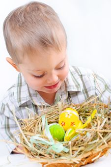 Little Boy With Easter Eggs In Basket Royalty Free Stock Image