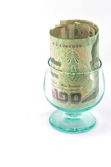 Thai  Baht In Glass Royalty Free Stock Images
