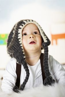 Free Baby Boy With Grey Cap Looking Up. Royalty Free Stock Photo - 18922725