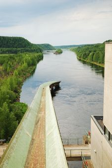 River With Hydro Power Plant In Taiga Stock Photos
