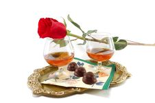 Rose And Glasses With Cognac And Sweets Stock Images