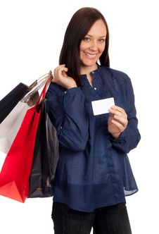 Pretty Woman Holding Shopping Bags And Credit Card Royalty Free Stock Photos