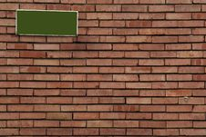 Brick Wall With Sign On It Stock Photos