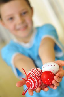 Free Easter Kid With Colorful Eggs Stock Photo - 18931470