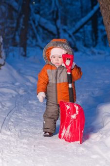 Adorable Baby Holding Snow Shovel Stock Photography