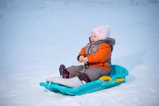Adorable Baby Sliding On Sleigh From Hill Royalty Free Stock Images