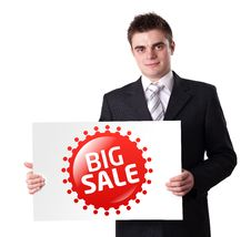 Free Man Holding BIG SALE Sign Stock Image - 18937991