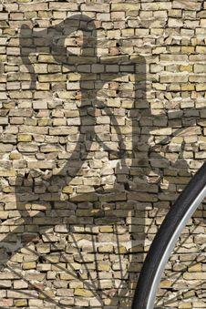 Free Bike Shadow Brick Wall Royalty Free Stock Photo - 18939265