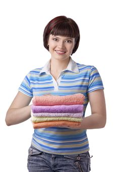 Free Woman Holding Clean Towels Stock Images - 18947244