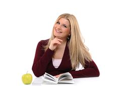 Free Pretty Casual Female With Green Apple Reading Book Stock Photography - 18948542