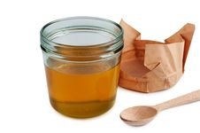 Honey In Jar With Wooden Spoon.