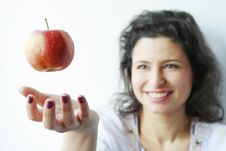 Free Woman Smiling At An Apple Floating In The Air Royalty Free Stock Photo - 18949695