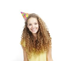 Smiling Woman In Birthday Hat Over White Royalty Free Stock Image