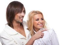 Free Young Happy Smiling Couple Pointing At Something Royalty Free Stock Photography - 18951977