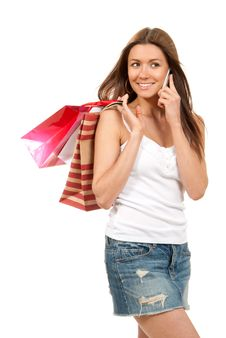 Free Woman Talking By Phone With Shopping Bags In Hand Royalty Free Stock Photos - 18959128